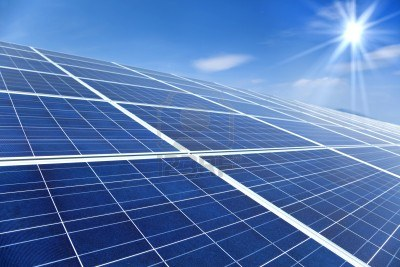 9545425-closeup-of-solar-panels-with-sunlight-and-blue-sky-background.jpg